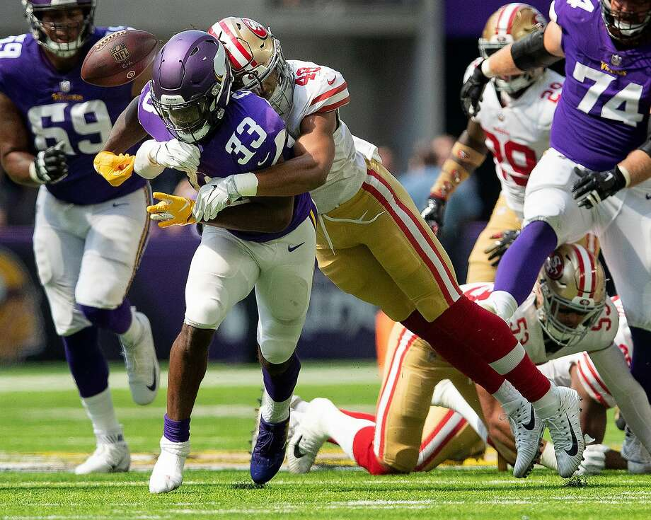 San Francisco 49ers' Fred Warner (48) forces Minnesota Vikings' Dalvin Cook (33) to fumble in the second quarter on Sunday, Sept. 9, 2018 at U.S. Bank Stadium in Minneapolis, Minn. (Carlos Gonzalez/Minneapolis Star Tribune/TNS) Photo: Carlos Gonzalez / TNS
