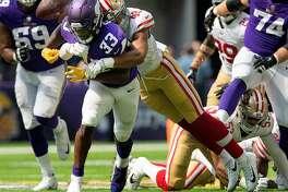 San Francisco 49ers' Fred Warner (48) forces Minnesota Vikings' Dalvin Cook (33) to fumble in the second quarter on Sunday, Sept. 9, 2018 at U.S. Bank Stadium in Minneapolis, Minn. (Carlos Gonzalez/Minneapolis Star Tribune/TNS)