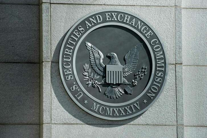"""This file photo taken on May 3, 2013, shows a view of the Securities and Exchange Commission headquarters in Washington, DC. An SEC enforcement official told Congress in May that the agency has """"dozens of investigations that are ongoing"""" focused on digital currencies."""