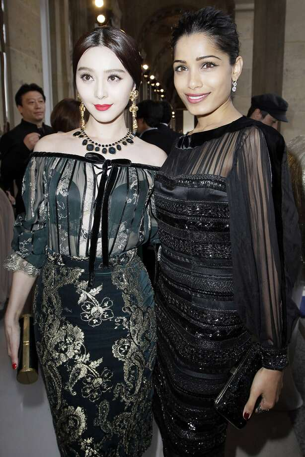 L'Oreal girl Fan Bing Bing, left, and actress Frida Pinto arrive for the Salvatore Ferragamo Cruise 2013 fashion show at Louvre Museum in Paris, France, Tuesday, June 12, 2012. (AP Photo/Francois Mori) Photo: Francois Mori, Associated Press