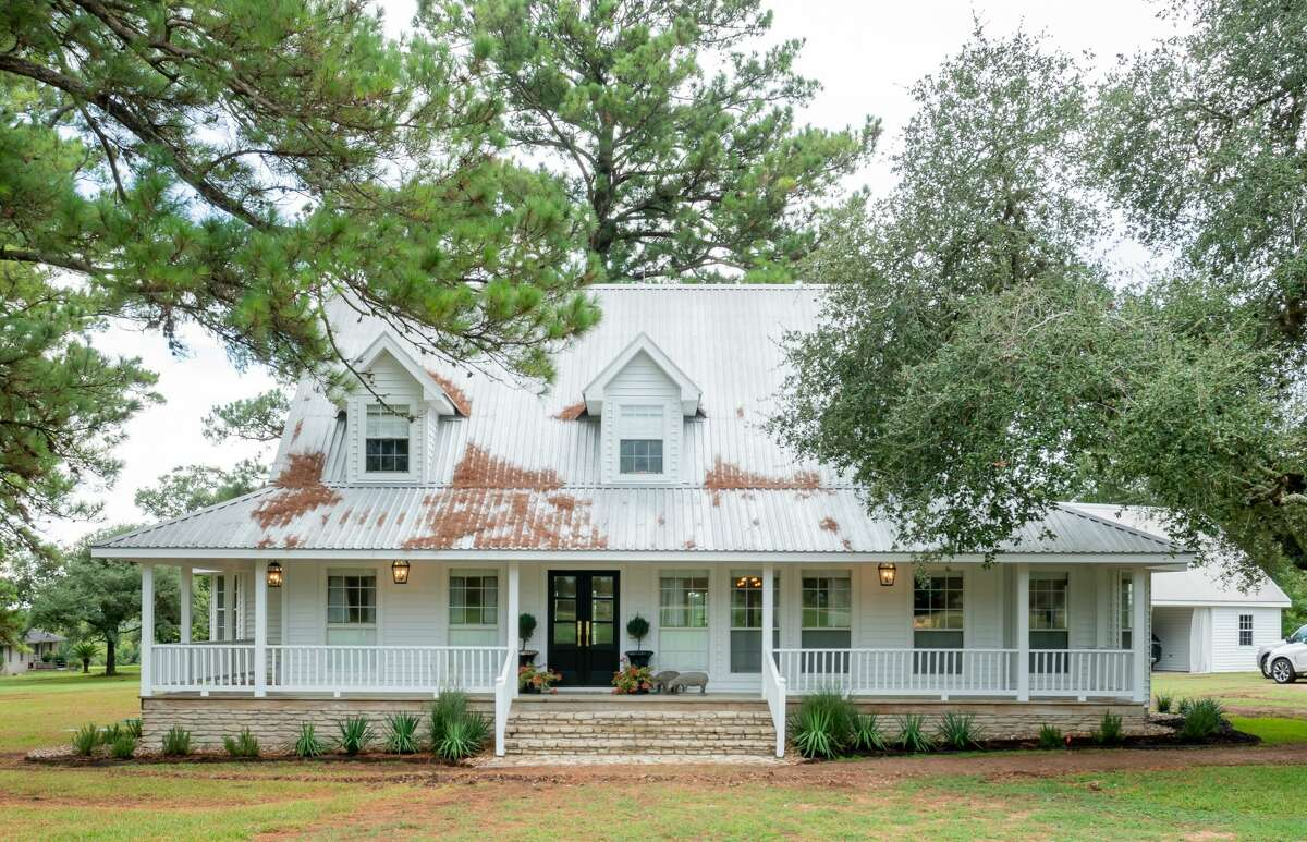 After: Renea Abbot and her husband Greg Manteris transformed this country home in Round Top. Before it was blue and white. The exterior is now all white and they added double doors to the front. The porch now wraps around three sides of the home.