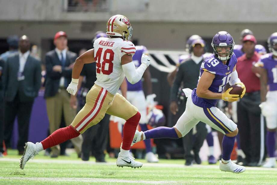 MINNEAPOLIS, MN - SEPTEMBER 09: Adam Thielen #19 of the Minnesota Vikings carries the ball after a reception against Fred Warner #48 of the San Francisco 49ers during the game on September 9, 2018 at U.S. Bank Stadium in Minneapolis, Minnesota. The Vikings defeated the 49ers 24-16. (Photo by Hannah Foslien/Getty Images) Photo: Hannah Foslien / Getty Images / 2018 Hannah Foslien