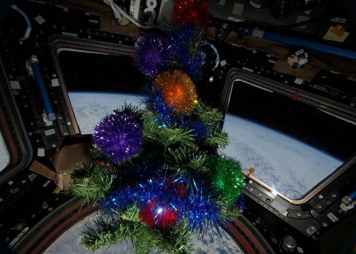 Astronaut Scott Kelly is in the midst of spending a whole year onboard the International Space Station. He celebrated the 2015 holiday season using some decorations brought up by a previous crew. This small decorated Christmas tree gets pulled out in December to cheer up the look of the ISS. Kelly tweeted his own photo of the decor with Earth in the background on December 25, 2015, along with this message: