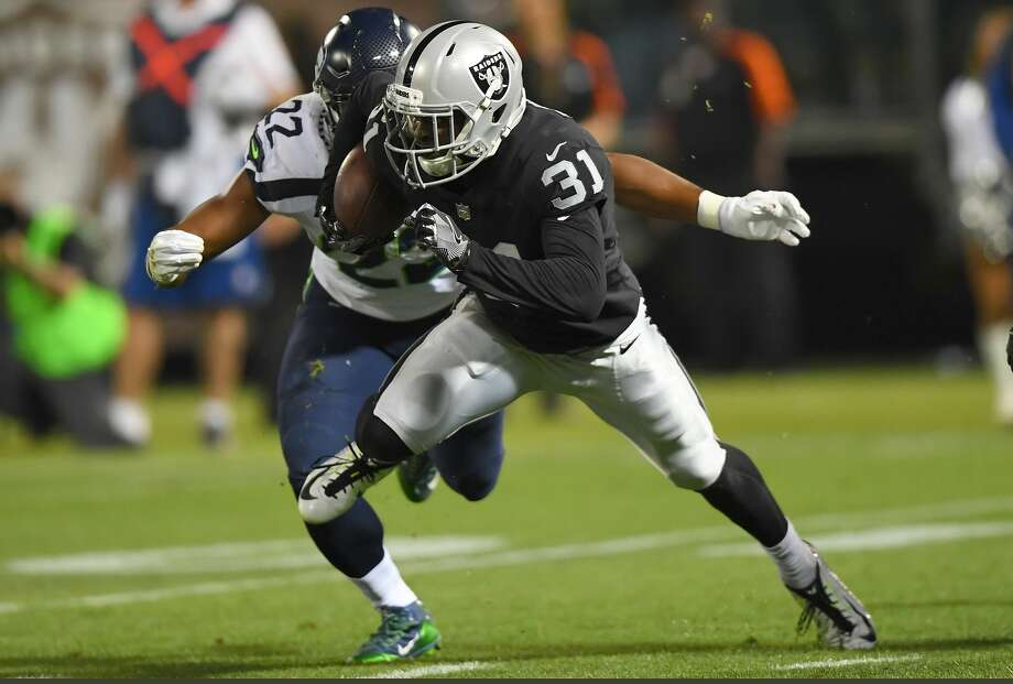 OAKLAND, CA - AUGUST 31:  Breon Borders #31 of the Oakland Raiders runs with the ball while pursued by C.J. Prosise #22 of the Seattle Seahawks during the second quarter at Oakland-Alameda County Coliseum on August 31, 2017 in Oakland, California.  (Photo by Thearon W. Henderson/Getty Images) Photo: Thearon W. Henderson/Getty Images