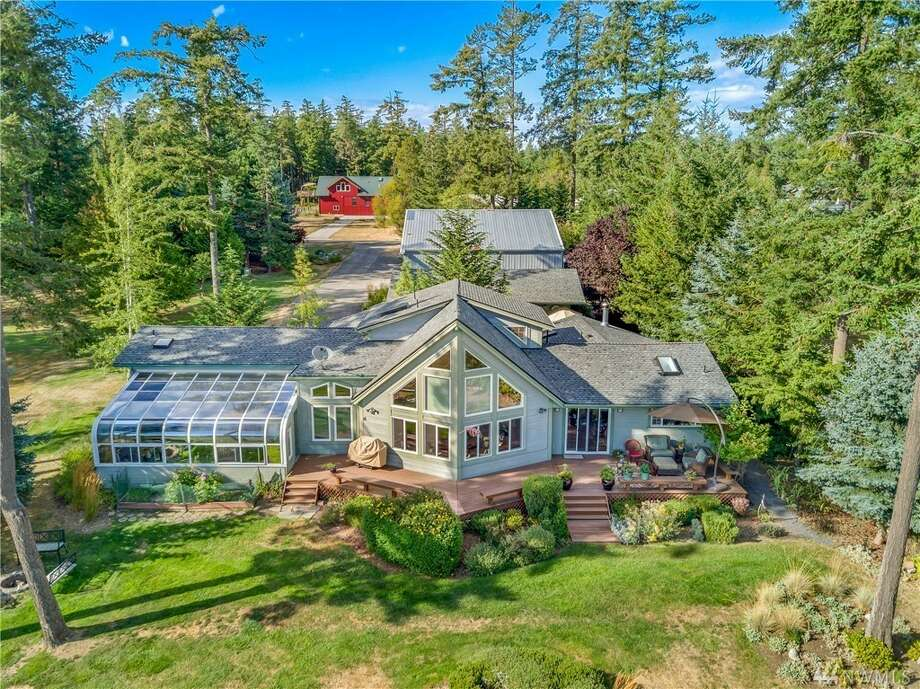 A Friday Harbor home with its own airplane hangar? Yep. Asks $1.250M Photo: Wes Edholm Via  Monica Van Appel-Percich /Windermere