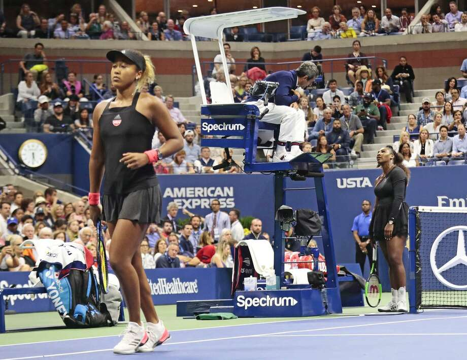 Serena Williams and chair umpire Carlos Ramos got into a dispute during the U.S. Open final Saturday. Naomi Osaka (left) outplayed Williams en route to her first Grand Slam title. Photo: Andres Kudacki / Associated Press / Copyright 2018 The Associated Press. All rights reserved