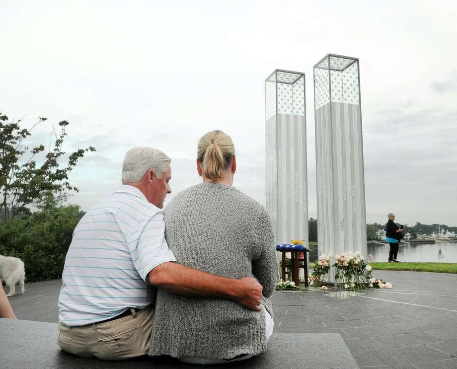 Husband and wife Paul and Maureen Colligan of Greenwich spent a moment of quiet during the September 11th Remembrance Service at Cos Cob Park in the Cos Cob section of Greenwich, Conn., Tuesday, Sept. 11, 2018. Maureen Colligan's brother Kevin Cleary was killed in the 9/11 attacks. Thirty-three people with close ties to Greenwich were killed in the 9/11 attacks. Photo: Bob Luckey Jr. / Hearst Connecticut Media / Greenwich Time