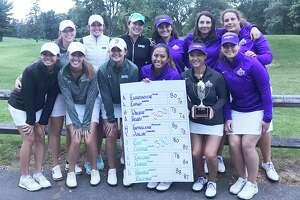The UAlbany and Siena women's golf teams participated in the Crosstown Challenge Cup Sunday at Wolfert's Roost. Posing with the cup are, from left, back row, Sara Riso of Siena, Grace Cuttone, Siena, Abigail Chai Onn, Siena, Pasqualina Tartaglione, UAlbany, Caroline Juillat, UAlbany, and Megan Henry, who took medalist honors with a 64 for UAlbany. Front row: Ashley Nguyen, Siena, Marisa Fiorina, Siena, Lena Kaufman Siena, Annika Espino, UAlbany, Madison Walker, UAlbany, and Helga Einarsdottir, UAlbany. UAlbany won the cup 300-332.