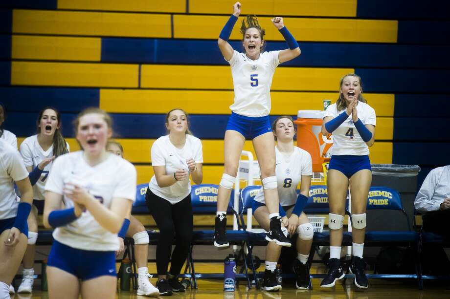 Midland junior Edie Haase jumps up into the air to celebrate a point during a match against Mount Pleasant on Tuesday, Sept. 11, 2018 at Midland High School. (Katy Kildee/kkildee@mdn.net) Photo: (Katy Kildee/kkildee@mdn.net)