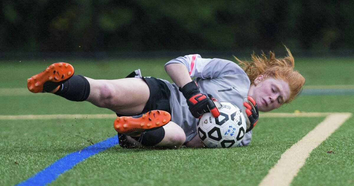 Darien High School goalie Caroline Orphanos dives on the ball in front of her goal during a girls soccer match against Trumbull High School played at Trumbull High School, Trumbull, CT. Tuesday, September 11, 2018.