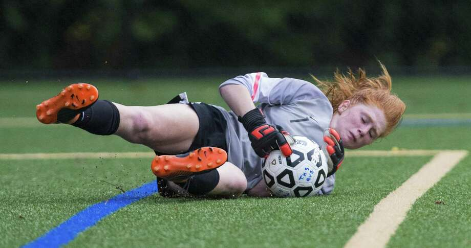 Darien High School goalie Caroline Orphanos dives on the ball in front of her goal during a girls soccer match against Trumbull High School played at Trumbull High School, Trumbull, CT. Tuesday, September 11, 2018. Photo: Mark Conrad / For Hearst Connecticut Media / Connecticut Post Freelance