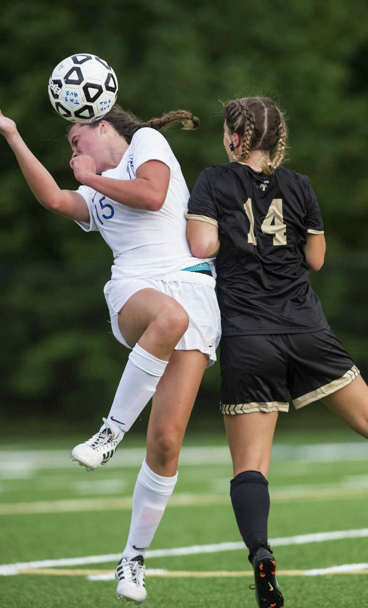 Darien High School?'s Shea Dolce heads the ball during a girls soccer match against Trumbull High School played at Trumbull High School, Trumbull, CT. Tuesday, September 11, 2018.