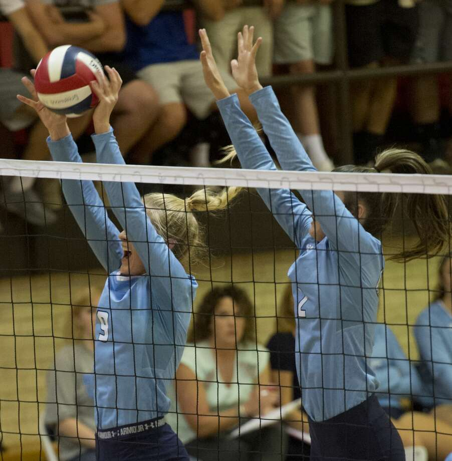 Greenwod's Edie Coleman and Kylee Smith go up for a block 09/11/18 as they take on Monahans in Greenwood gym. Tim Fischer/Reporter-Telegram Photo: Tim Fischer/Midland Reporter-Telegram