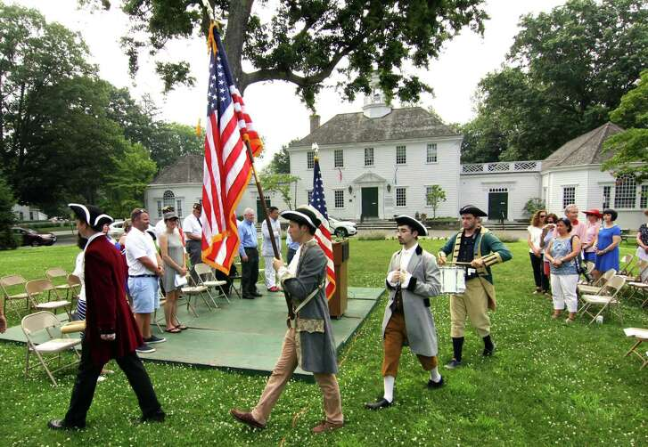 Members of Fairfield Teen Theater dressed as some of the Founding Fathers, march in a Procession of Colors to open Fairfield United Veterans Organization's 125th Annual Independence Day Celebration at Town Hall in Fairfield, Conn., on Wednesday July 4, 2018. The event was co-hosted by the Eunice Dennie Burr Chapter of the Daughters of the American Revolution (DAR).