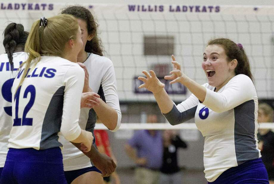 Willis' Erin Bond (6) jokes with Taylor Thomas (12) during the second set of a District 20-5A high school volleyball match at Willis High School on Tuesday, Sept. 11, 2018, in Willis. Photo: Jason Fochtman, Houston Chronicle / Staff Photographer / © 2018 Houston Chronicle