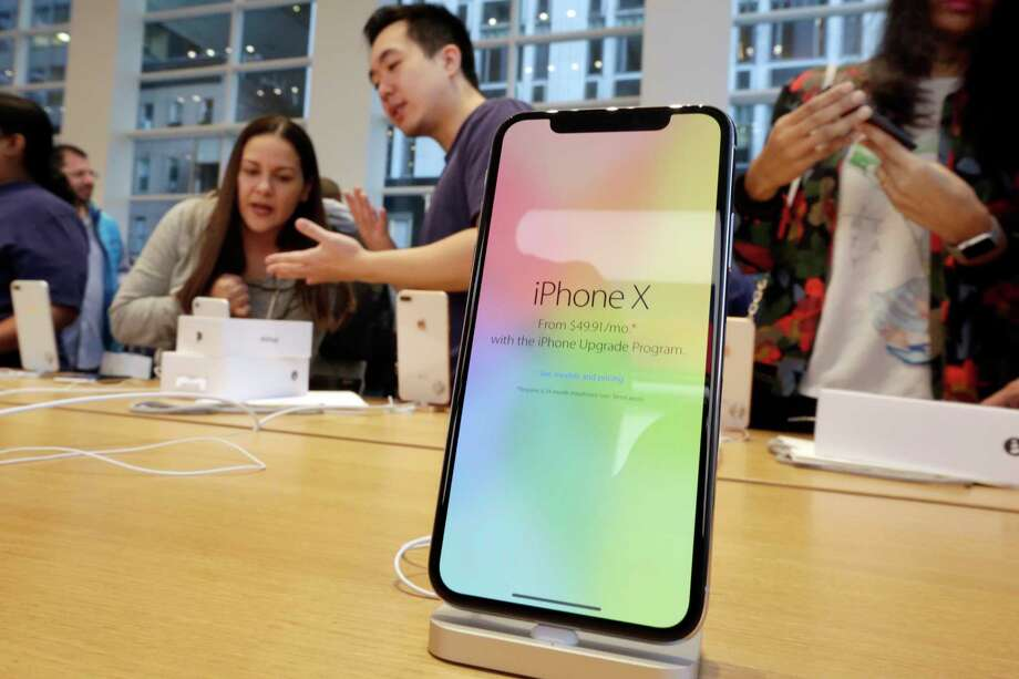 FILE - In this Nov. 3, 2017, file photo, customers buy the iPhone X at the Apple Store on New York's Fifth Avenue. Apple is expected to unveil its biggest and most expensive iPhone on Wednesday, Sept. 12, 2018, as part of a lineup of three new models aimed at widening the product's appeal amid slowing sales growth. (AP Photo/Richard Drew, File) Photo: Richard Drew / AP
