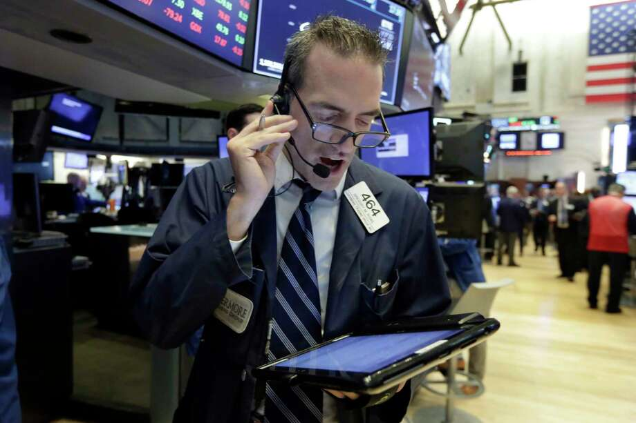 FILE- In this Sept. 6 2018, file photo trader Gregory Rowe works on the floor of the New York Stock Exchange. The U.S. stock market opens at 9:30 a.m. EDT on Tuesday, Sept. 11. (AP Photo/Richard Drew, File) Photo: Richard Drew / Copyright 2018 The Associated Press. All rights reserved