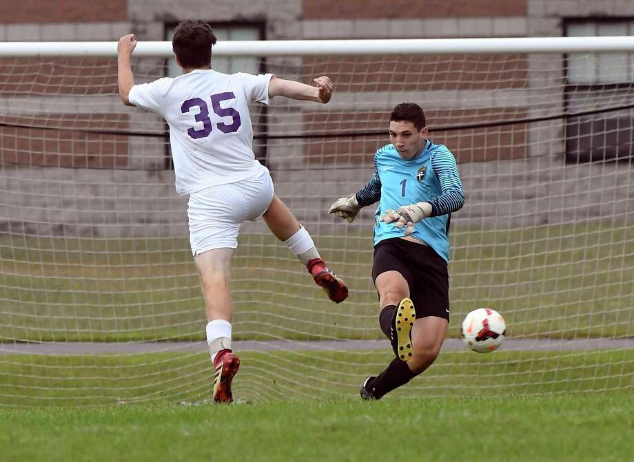 Christian Brothers Academy goalkeeper Dan Keey (1) clears the ball past Ballston Spa's Devin Duttine (35) during a Section II boys' soccer game Tuesday, Sept. 11, 2018, in Colonie, N.Y. (Hans Pennink / Special to the Times Union) Photo: Hans Pennink / Hans Pennink