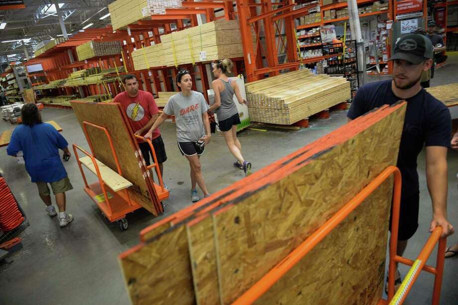 Customers push carts with plywood at Home Depot in Wilmington, N.C., on Tuesday, ahead of Hurricane Florence. Photo: Bloomberg Photo By Charles Mostoller / Bloomberg