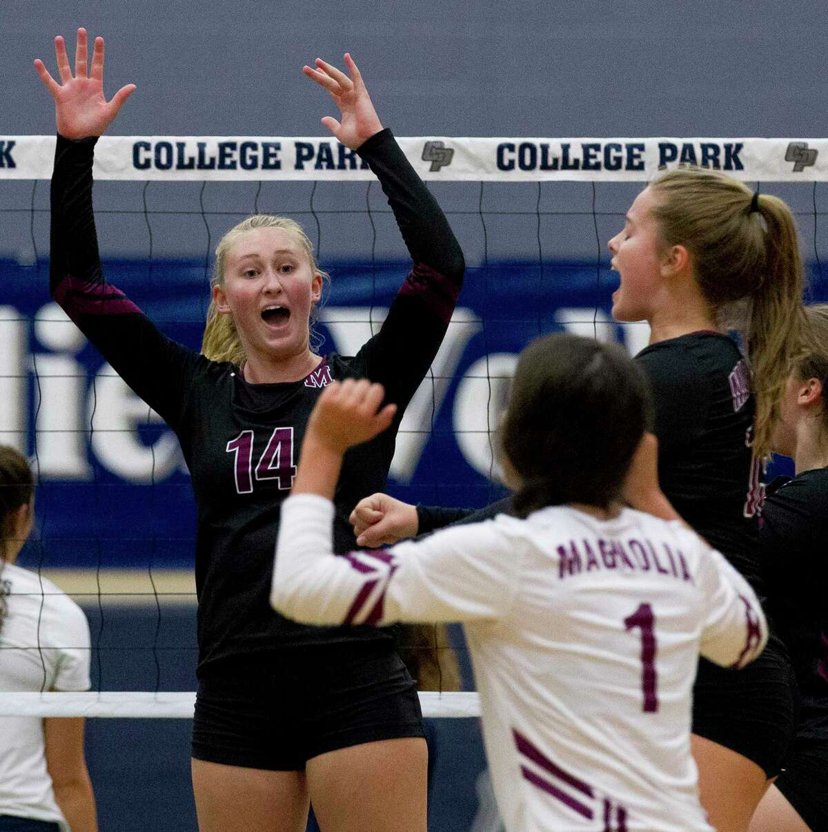 Magnolia's Ellie Anderson (14) reacts after scoring a point during the first set of a non-district high school volleyball match at College Park High School on Saturday, Aug. 25, 2018, in The Woodlands