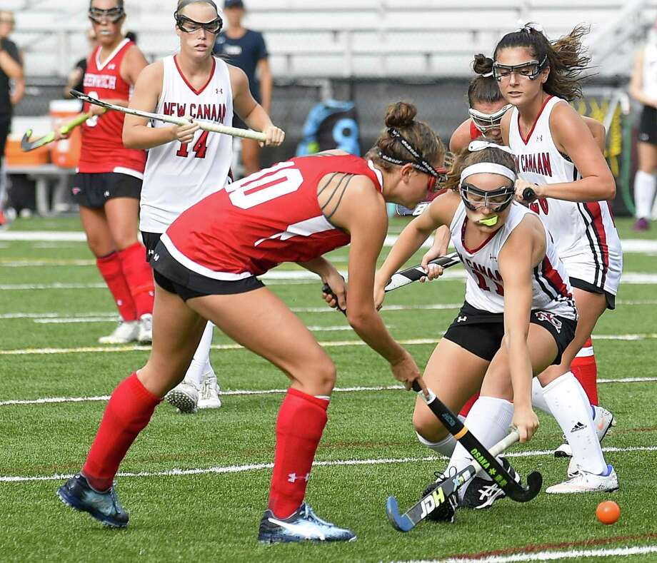 New Canaan's Brielle Connelly (11) battles for the ball with Greenwich's Charlotte Gans (10) during a girls field hockey game at Dunning Field in New Canaan, Conn. on Tuesday, Sept. 11, 2018. Photo: Matthew Brown / Hearst Connecticut Media / Stamford Advocate