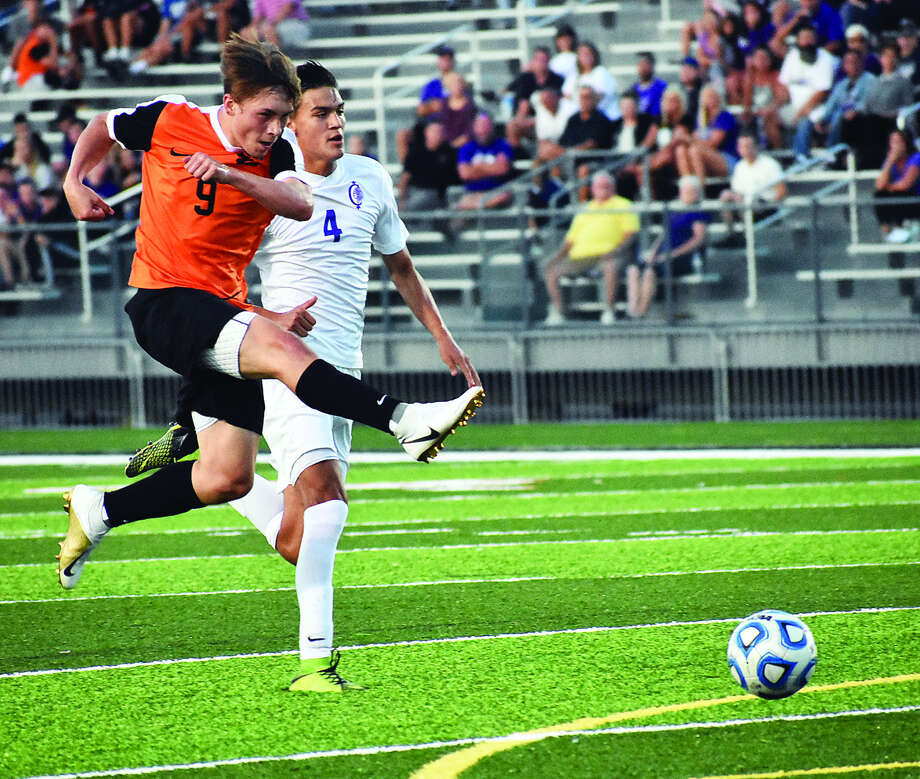 Edwardsville's Cooper Nolan blasts a shot wide midway through the first half of Tuesday's league game against Collinsville inside the District 7 Sports Complex. Photo: Matthew Kamp