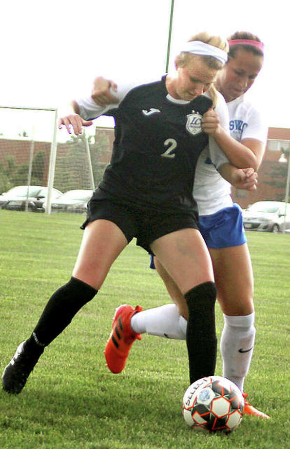 Taylor Hansen of Lewis and Clark Community College (2) battles for the ball with SWIC's Addison Hanusek during a game Thursday in Belleville. Photo: Pete Hayes | For The Telegraph