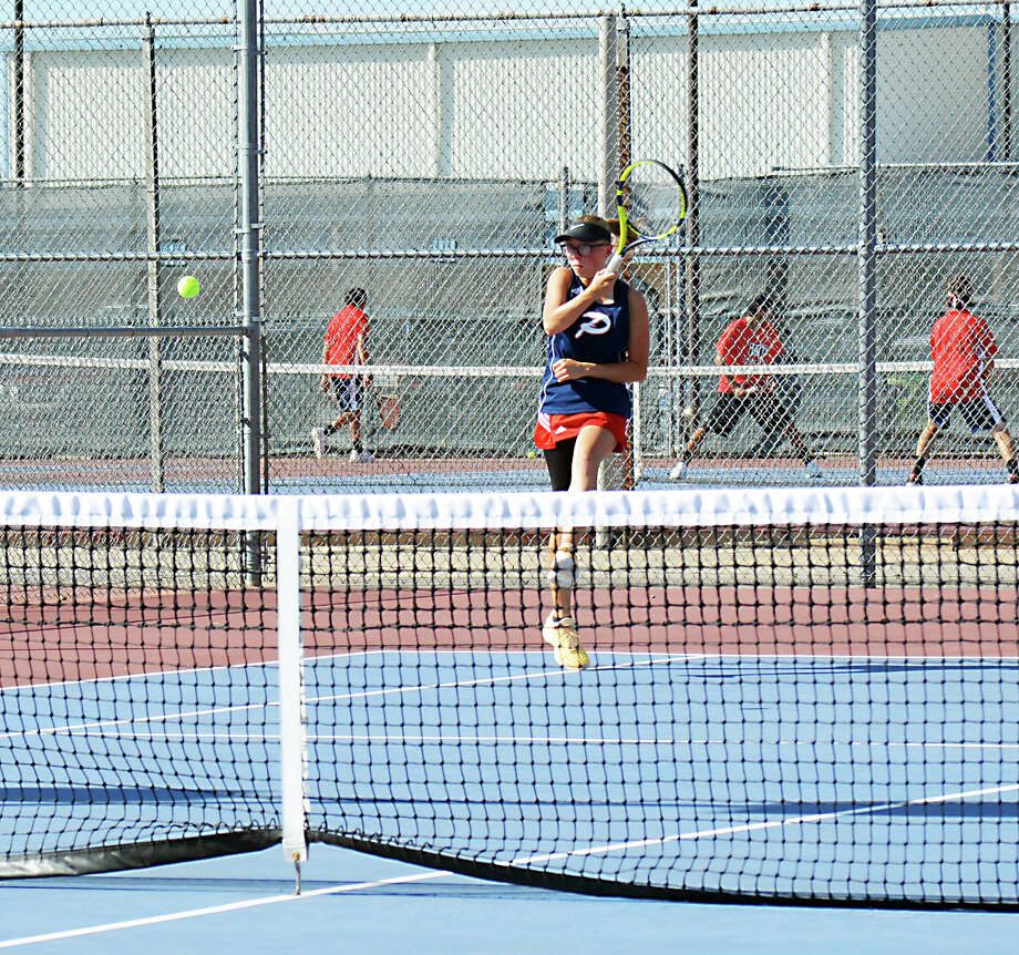 Plainview's Lizzie Terry sends back a shot during doubles action against Lubbock Cooper on Tuesday in Plainview. Photo: Alexis Cubit/Plainview Herald