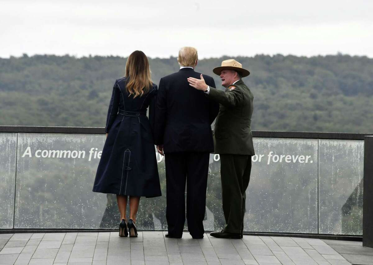 US President Donald Trump and First Lady Melania Trump look out on September 11, 2018, at the site of a new memorial in Shanksville, Pennsylvania where Flight 93 crashed during the September 11 attacks, as somber ceremonies take place at Ground Zero in New York and at the Pentagon. (Photo by Nicholas Kamm / AFP)NICHOLAS KAMM/AFP/Getty Images