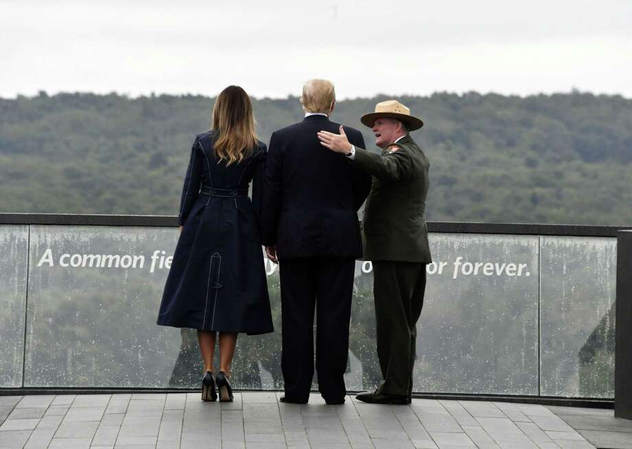 US President Donald Trump and First Lady Melania Trump look out on September 11, 2018, at the site of a new memorial in Shanksville, Pennsylvania where Flight 93 crashed during the September 11 attacks, as somber ceremonies take place at Ground Zero in New York and at the Pentagon. (Photo by Nicholas Kamm / AFP)NICHOLAS KAMM/AFP/Getty Images Photo: NICHOLAS KAMM / AFP or licensors