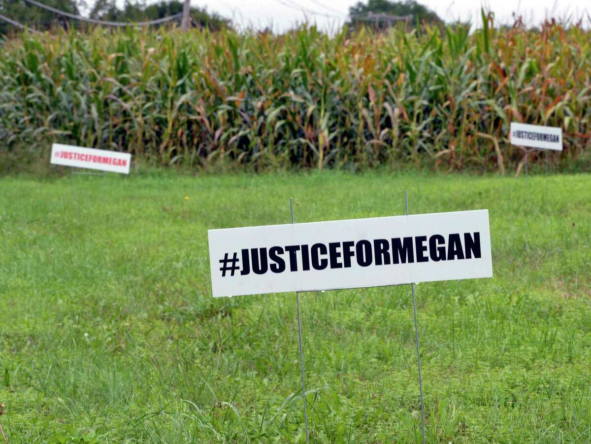 Justice for Megan signs outside the MacLean home on Route 67, Tuesday Sept. 11, 2018 in Johnsonville, NY. Police are unclear how Megan MacLean died before she was found on a trail behind her home on June 4. (John Carl D'Annibale/Times Union)
