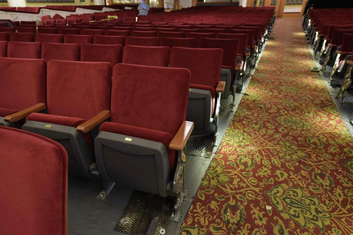 A view of the newly installed seats inside Proctors on Tuesday, Sept. 11, 2018, in Schenectady, N.Y. The new seats were part of a modernization project which included a new hearing loop. The loop will offer much improved clarity for persons with hearing loss who wear telecoil?-or T-coil?-equipped hearing aids. The new seats have wooden backs and charcoal grey and gold end standards facing the aisles and matching the carpet. The seats are wider, starting at 19 inches as opposed to old seats which were 17. (Paul Buckowski/Times Union)
