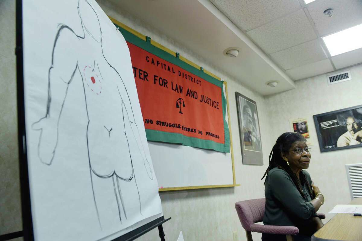 Alice Green, executive director of the Center for Law and Justice, talks to members of the media about the Albany Police Department?'s report on the shooting of Ellazar Williams, on Tuesday, Sept. 11, 2018, in Albany, N.Y. The drawing on the left is what Green says shows the area where Williams was shot in the back. (Paul Buckowski/Times Union)