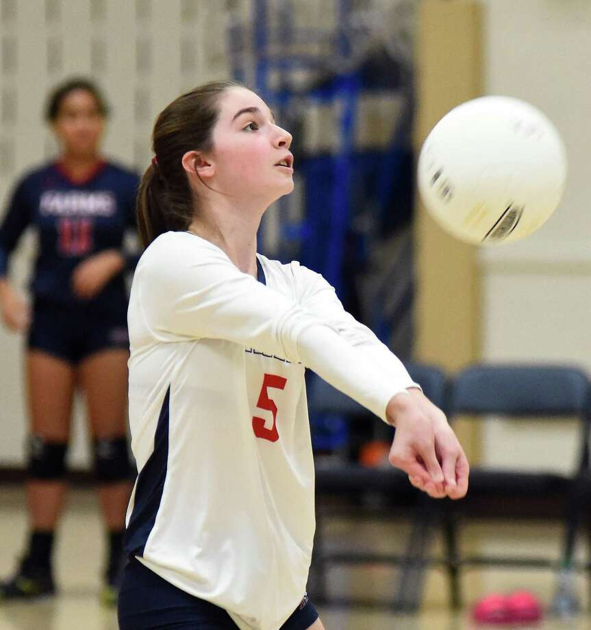 Greens Farms Academy volleyball senior captain Alex Nason of Darien bumps the ball for the Dragons during a game last season. Photo: Contributed Photo / GFA Athletic Communications