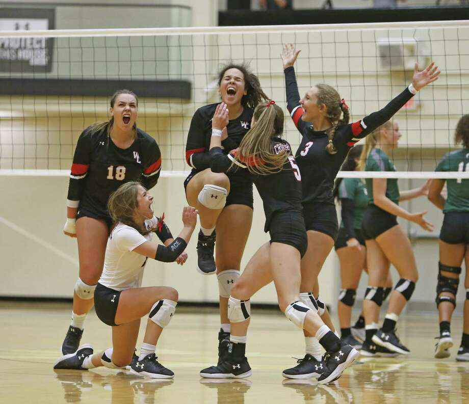 Churchill celebrates after winning their second set from the District 27-6A high school volleyball showdown between rivals Churchill and Reagan on Tuesday, September 11, 2018. Photo: Ronald Cortes, Photo Correspondent / 2018 Ronald Cortes