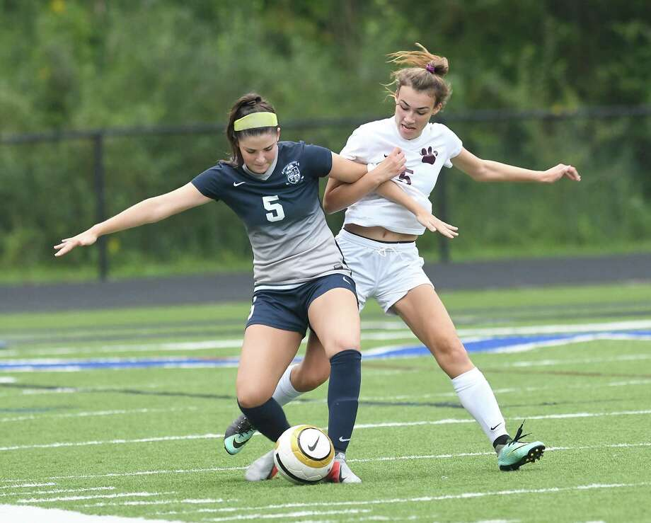 Immaculate's Morgan Cartee and Bethel's Hailey Kinsman fight for possession during the Immaculate vs. Bethel girls soccer game at Immaculate in Danbury, Sept. 11, 2018. Photo: Krista Benson / The News-Times Freelance