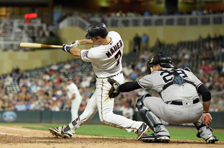 MINNEAPOLIS, MN - SEPTEMBER 11: Joe Mauer #7 of the Minnesota Twins hits a grand slam as Austin Romine #28 of the New York Yankees catches during the fifth inning of the game on September 11, 2018 at Target Field in Minneapolis, Minnesota. (Photo by Hannah Foslien/Getty Images) Photo: Hannah Foslien / 2018 Getty Images