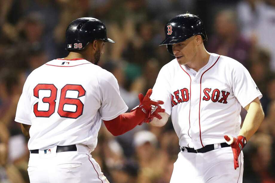 BOSTON, MA - SEPTEMBER 11: Brock Holt #12 of the Boston Red Sox celebrates with Eduardo Nunez #36 after hitting a three run home run against the Toronto Blue Jays during the seventh inning at Fenway Park on September 11, 2018 in Boston, Massachusetts.(Photo by Maddie Meyer/Getty Images) Photo: Maddie Meyer / 2018 Getty Images
