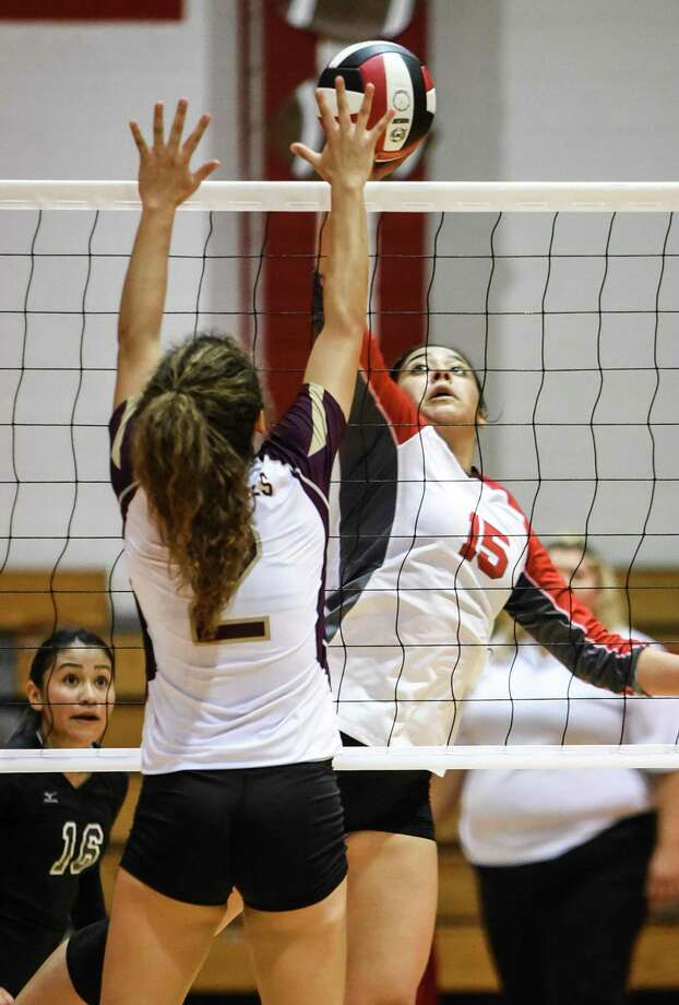 Martin High School Melanie Duron taps the ball over the net during a game against Tuloso-Midway High School on Tuesday, Sept. 11, 2018 at Martin High School. Photo: Danny Zaragoza /Laredo Morning Times