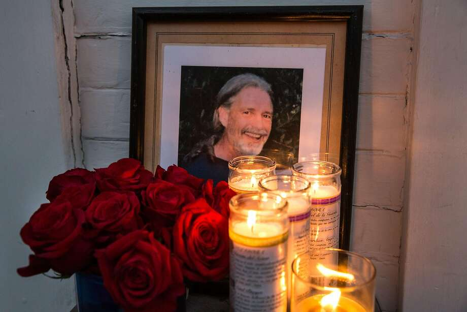 Framed photograph of Brian Egg surrounded by candles and roses placed outside of his house where family and friends gathered for a candle vigil in his honor on his birthday. He would have been 66 years old today. Tuesday, September 11, 2018 in San Francisco Calif. Photo: Jana Asenbrennerova / Special To The Chronicle