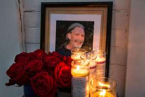 Framed photograph of Brian Egg surrounded by candles and roses placed outside of his house where family and friends gathered for a candle vigil in his honor on his birthday. He would have been 66 years old today. Tuesday, September 11, 2018 in San Francisco Calif.