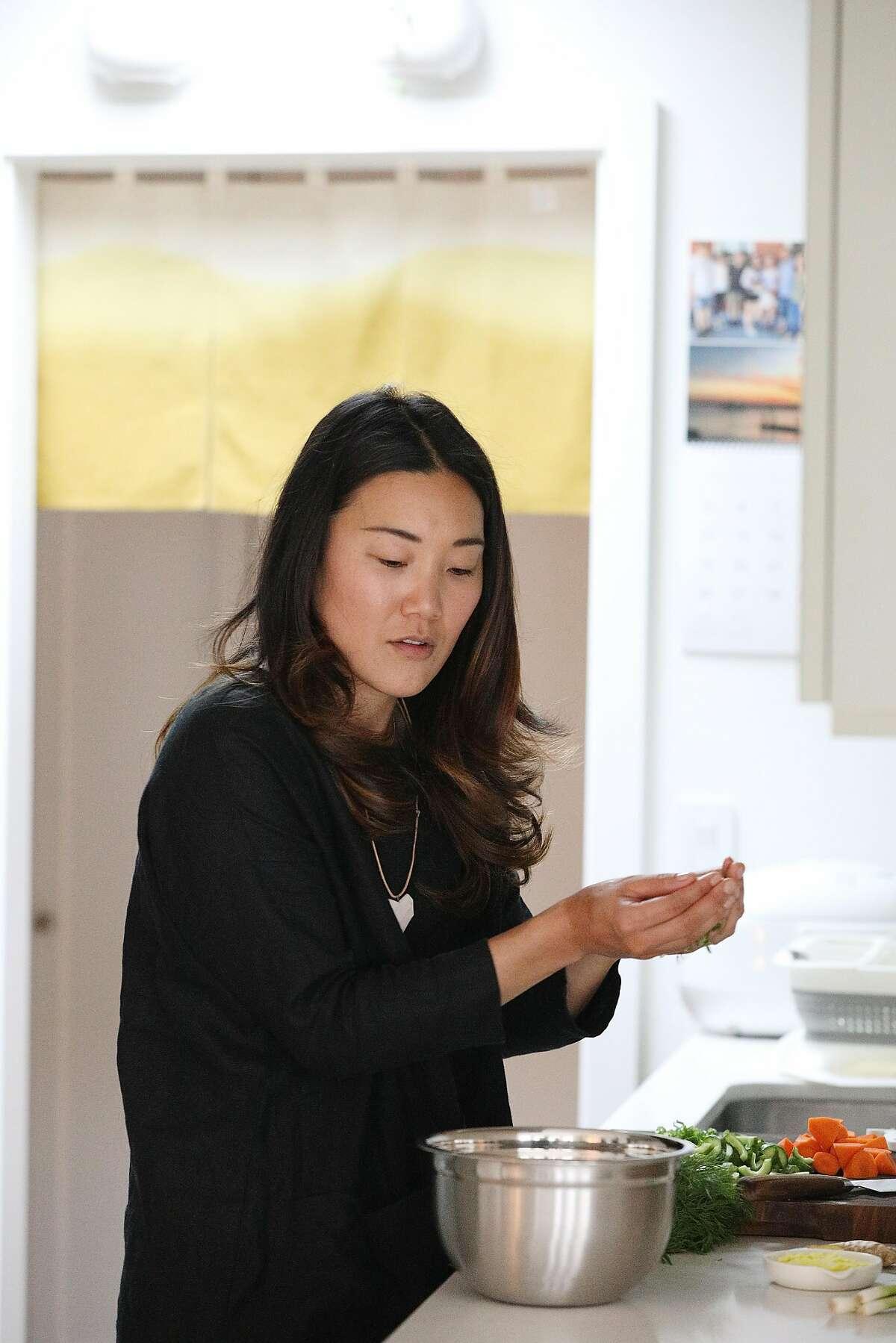 "Kristin Eriko Posner makes Tsukune ""Matzah Ball"" soup in her kitchen on Wednesday, August 22, 2018 in San Francisco, Calif."