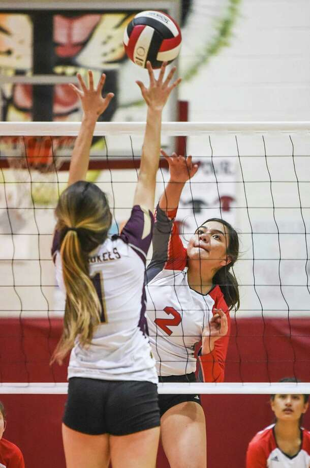 Martin High School Karla Hernandez hits the ball over the net during a game against Tuloso-Midway High School on Tuesday, Sept. 11, 2018 at Martin High School. Photo: Danny Zaragoza /Laredo Morning Times File