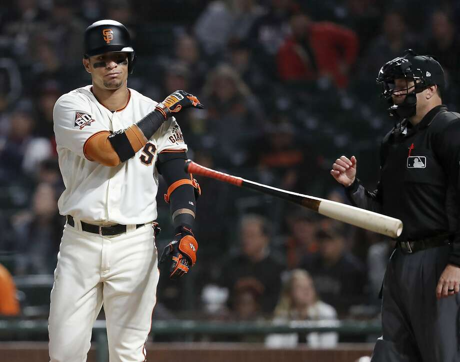 San Francisco Giants' Gorkys Hernandez throws his bat after striking out against the Atlanta Braves during the first inning of a baseball game in San Francisco, Tuesday, Sept. 11, 2018. (AP Photo/Tony Avelar) Photo: Tony Avelar, Associated Press