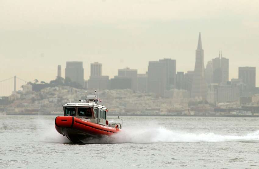 A U.S. Coast Guard boat patrols San Francisco Bay March 25, 2003 in California. The Department of Homeland Security has increased security at major ports and waterways since the start of the Iraq war. (Photo by David Paul Morris/Getty Images)