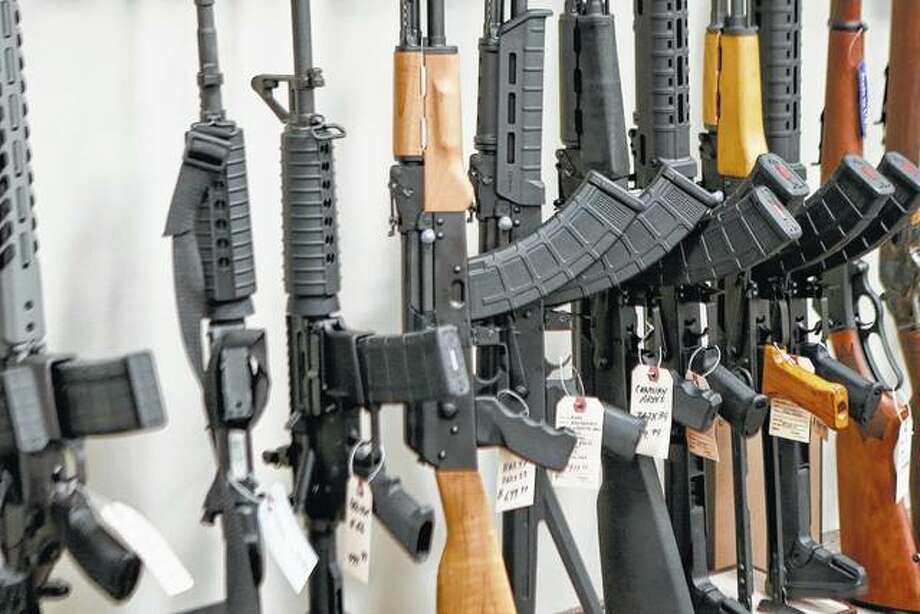 A display of various models of semi-automatic rifles are seen in March at a store in Pennsylvania. Research published Tuesday in the Journal of the American Medical Association shows active shooters with semi-automatic rifles wound and kill twice as many people as those using non-automatic weapons. Photo: Keith Srakocic | Associated Press