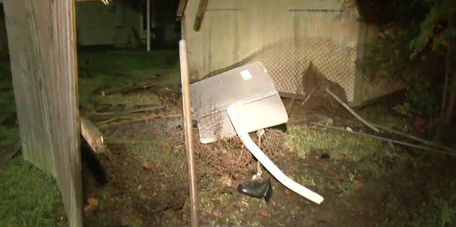 A driver crashed through a resident's backyard on Fuqua near Aldis, on Wednesday, Sept. 12, 2018. Photo: Metro Video