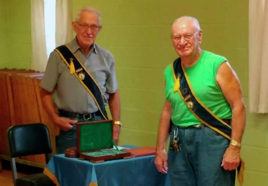 Dale Moore, right, was recognized for 55 years of membership to Studley Grange at the August meeting. On the left is Ted Mudd, Studley Grange master/president. (Photo provided)