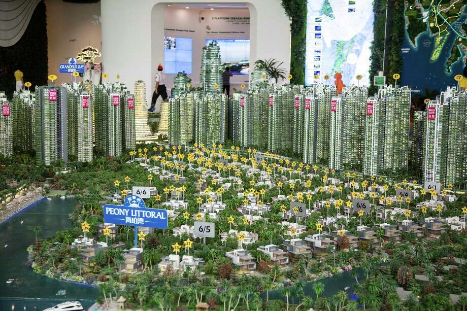 A model of the Forest City development is displayed at the Country Garden Holdings property showroom in Johor Bahru, Malaysia. Photo: Photo For The Washington Post By Ore Huiyin / For The Washington Post