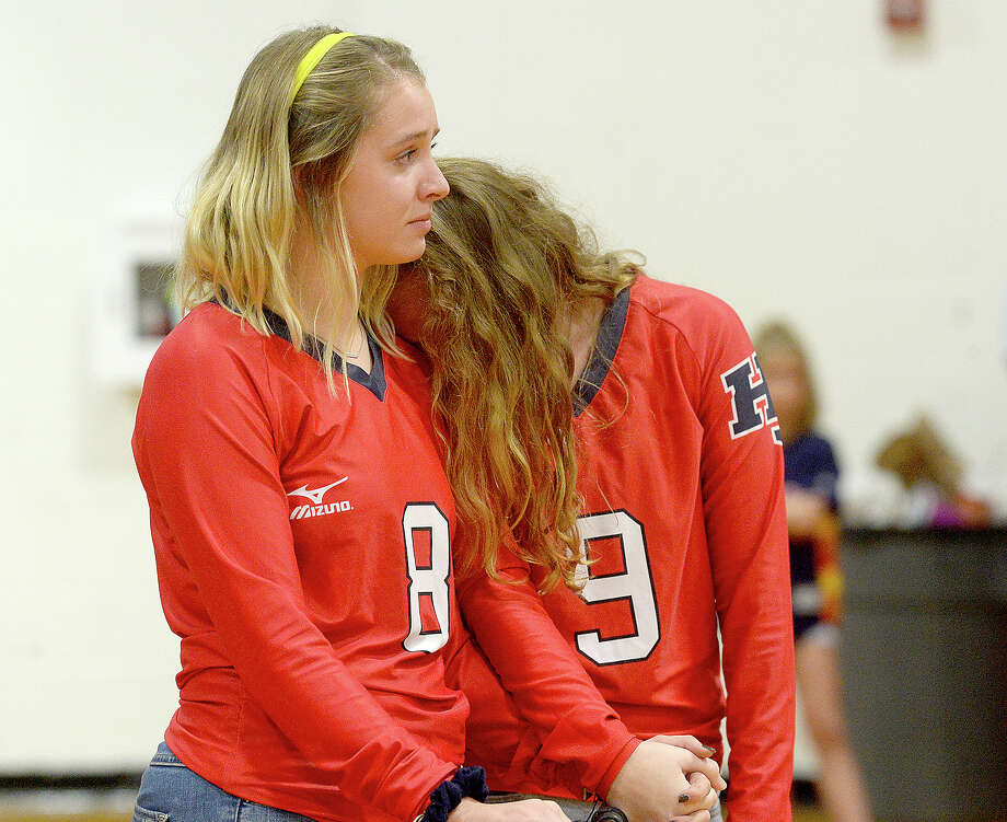 Hardin-Jefferson's  Emma Martin (left) and Abbie Jewell become eotional during a moment of silence in honor of 2018 graduate Alix Neel before Tuesday night's volleyball game at Lumberton High School. Neel was one of three Hardin County teens killed in an accident Sunday. A community vigil for the crash victims, friends and family is planned for 5:30 p.m. Wednesday at Praise Church in Beaumont. Tuesday, September 11, 2018 Kim Brent/The Enterprise Photo: Kim Brent/The Enterprise